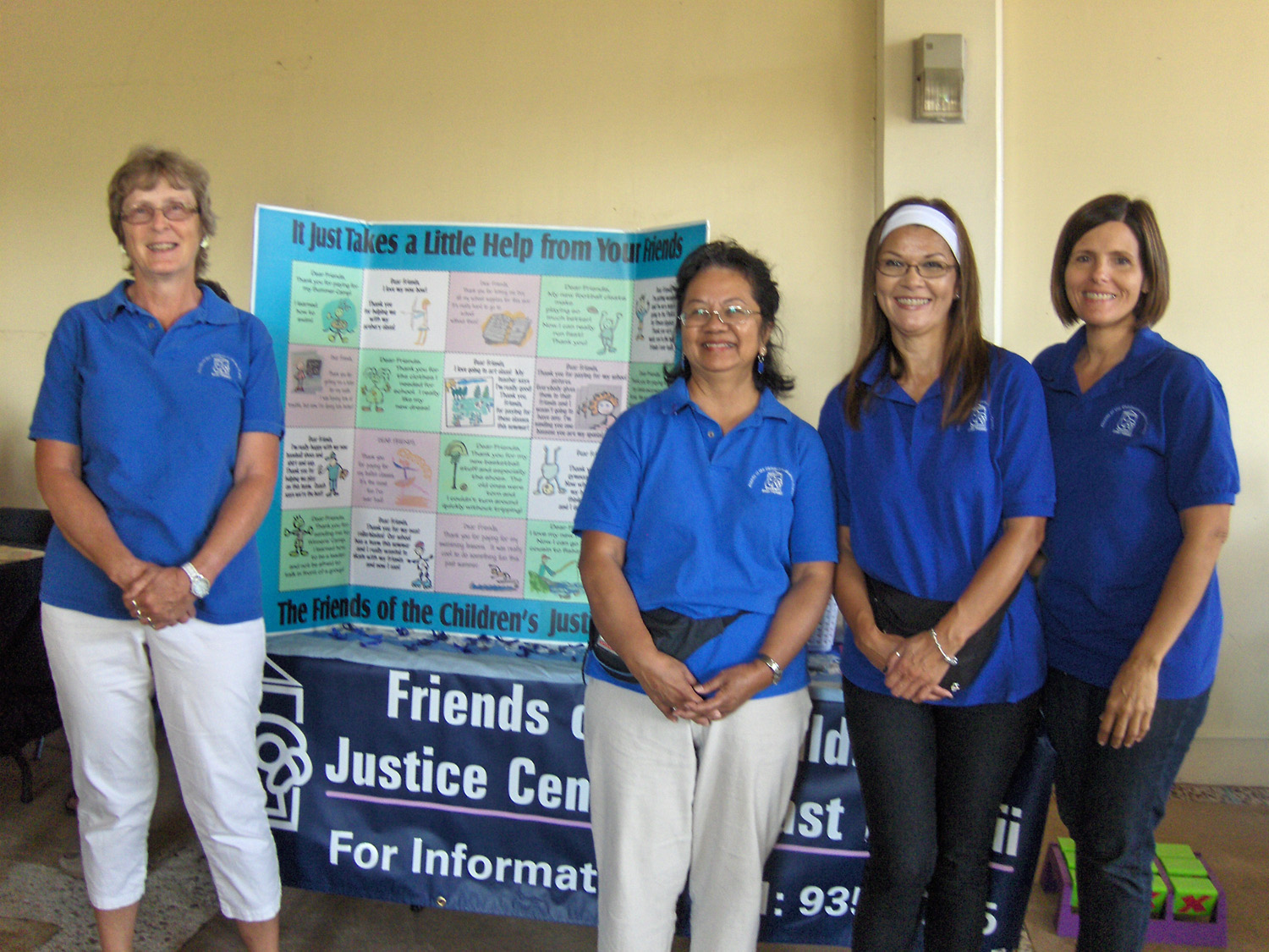 This photo shows Staff and volunteers at a community information Fair.