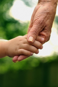 This picture of an adult hand holding a child's hand represents the Friends help.