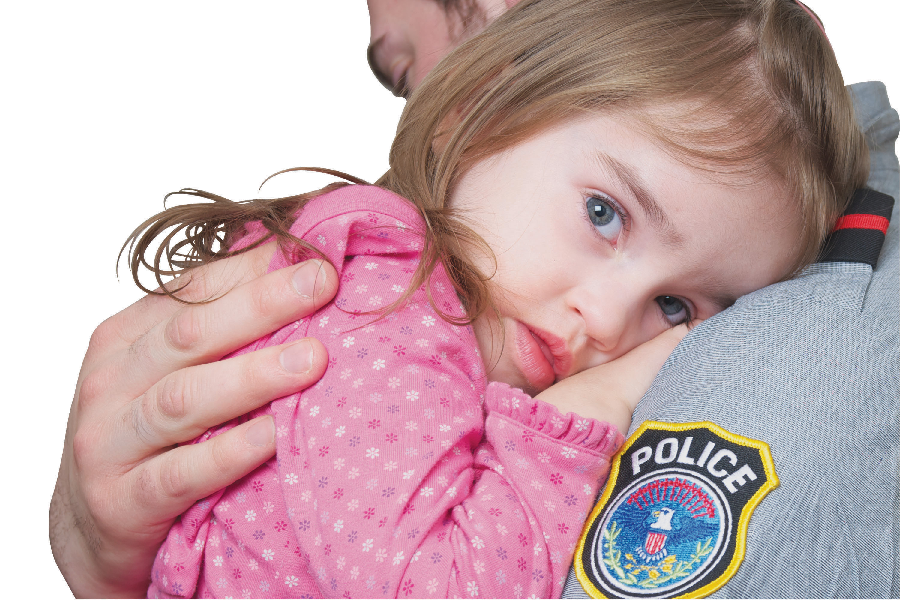 This is a photo of a little girl in the arms of a police officer.